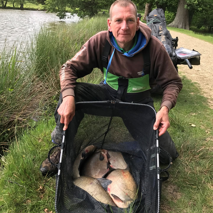 Keith with his winning catch of Bream